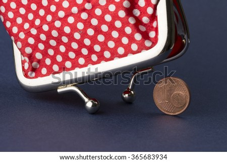 Wallet and last euro cent - stock photo