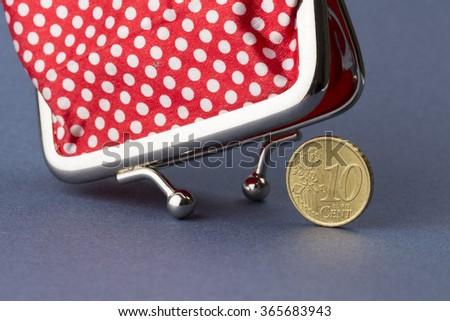 Wallet and last ten euro cent on blue background