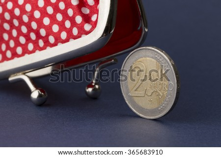 Wallet and last two euro  - stock photo