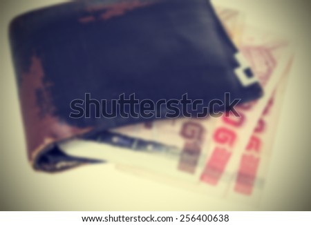 Wallet and Thai bank notes vintage style, Image blur
