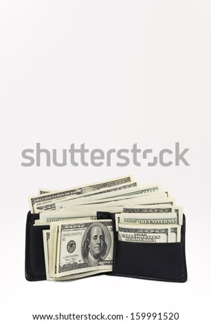 Wallet Full of Hundred Dollar Bills (with clipping path) - stock photo