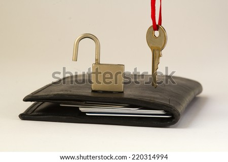 wallet key and padlock/money safety - stock photo
