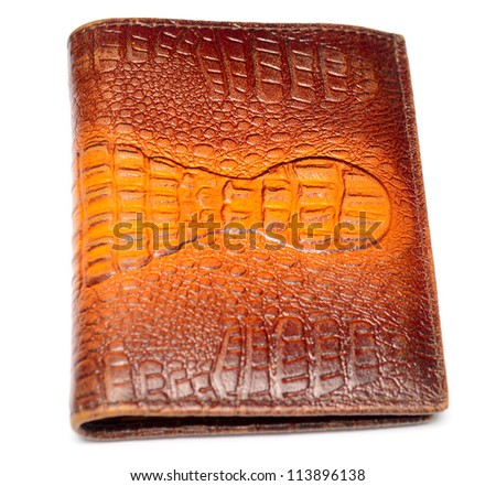 Wallet made of genuine crocodile leather over white background - stock photo