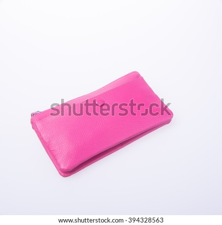 wallet or purse with dollars and credit cards on background