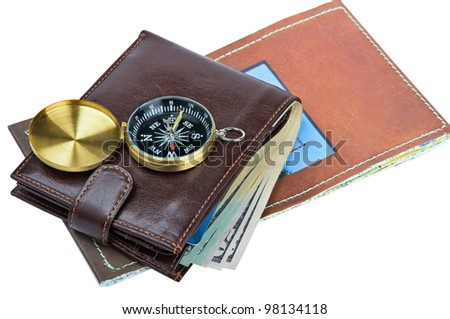 Wallet with banknotes, credit card and compass on a map. Image is isolated on white. - stock photo