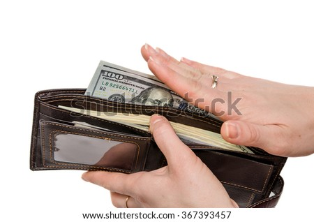 wallet with dollars in the woman hands isolated