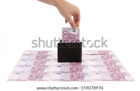 Wallet with five hundreds euro banknotes. On a banknotes background