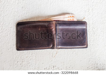 Wallet with money   isolated on  white background,vintage - stock photo