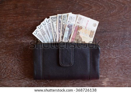 Wallet with Russian rubles, dollars and euros. Foreign currency savings concept  - stock photo