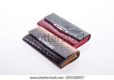wallet, woman or lady wallet on the background.