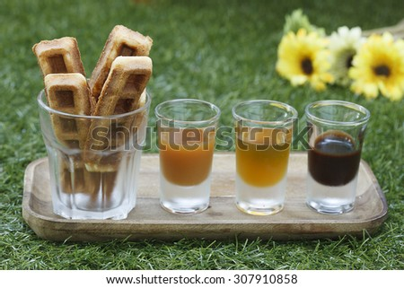 Wallfes with syrup on grass background