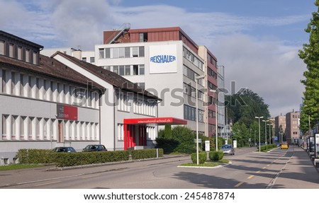 Wallisellen, Switzerland - 4 August, 2014: International School and Reishauer buildings on the Richtistrasse street. Wallisellen is a municipality in the canton of Zurich in Switzerland.