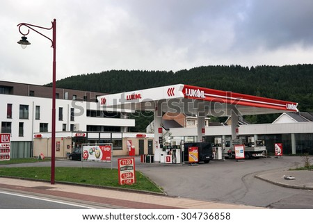 WALLONIA, BELGIUM - JULY 29: Lukoil Petrol Station. LUKOIL is a major international oil & gas company and Russia's second largest oil company. Photo taken on July 29, 2015 in Malmedy, Belgium. - stock photo