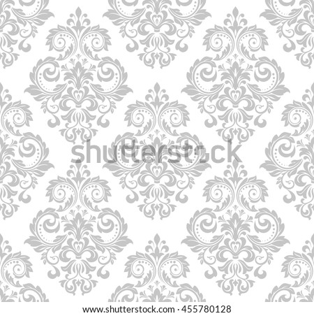 Wallpaper in the style of Baroque. A seamless background. Gray and white texture. Floral ornament. Graphic pattern. - stock photo