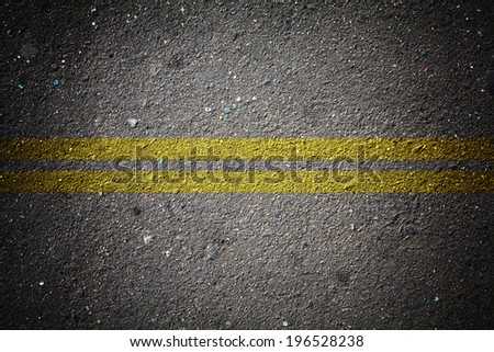 wallpaper of dry asphalt texture with double solid line