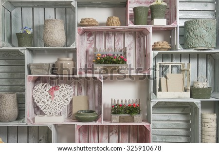 wallpaper with hand made shelf wall, vintage wooden painted crate - stock photo
