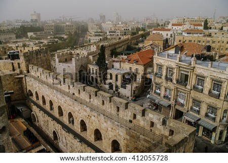 Walls and castle of old city. Jerusalem panoramic roof view in time of sand storm. Israel - stock photo