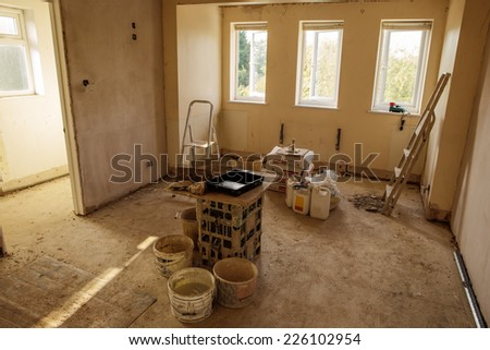 walls and ceiling being plastered - stock photo
