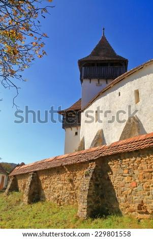 Walls of fortified church from UNESCO world heritage list in Viscri village, Transylvania, Romania - stock photo