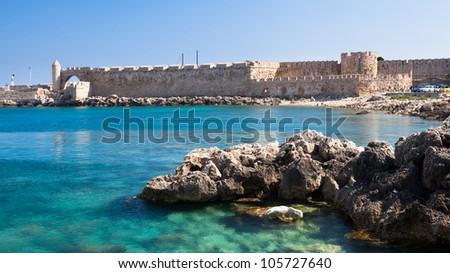 Walls of the old town taken from Mandraki Harbour Rhodes Greece - stock photo
