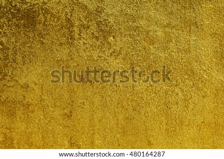 Walls painted gold background /Background gold-painted plaster walls .