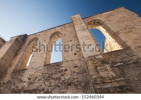 Walls with Gothic windows of ancient ruined St. Brigitta convent. Tallinn, Estonia - stock photo