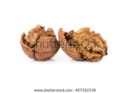 walnut and a cracked walnut isolated on the white background.