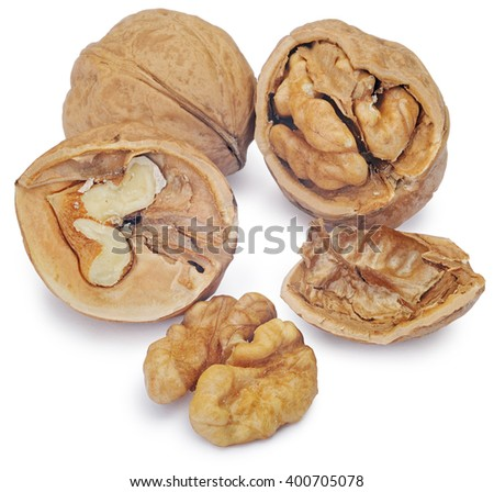 Walnut and a cracked walnut isolated on the white background. Clipping Path - stock photo