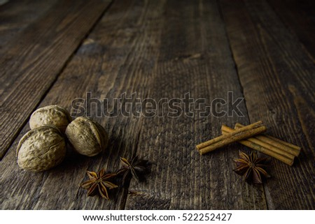 walnut anise cinnamon sticks on a wooden background