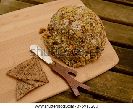 walnut cheese ball on rustic wood table - stock photo