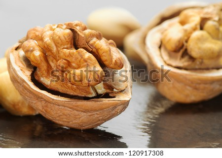 walnut close up over wet ardesia - stock photo