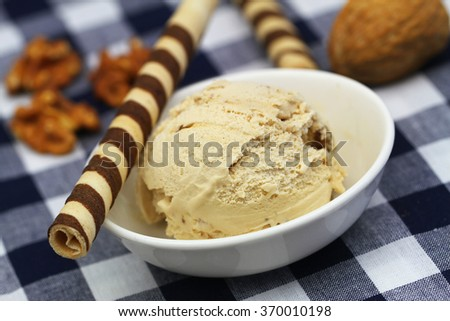 Walnut ice cream with chocolate wafers on checkered cloth