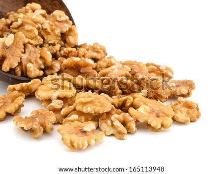 Walnut in wooden bowl on white  - stock photo