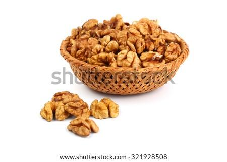 Walnut kernels isolated on white - stock photo