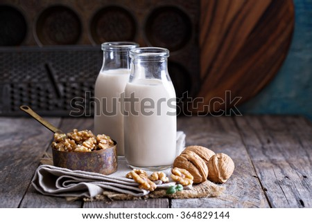 Walnut nut vegan milk non dairy in different bottles with copy space - stock photo