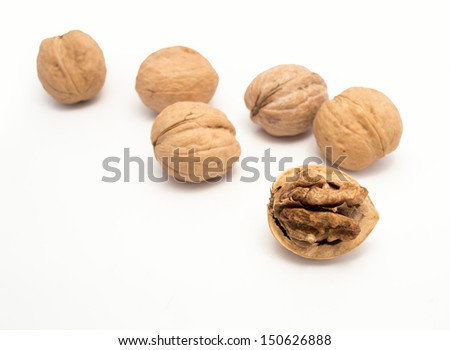 walnut open and others closed on White Background - stock photo