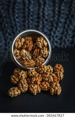 Walnut pieces inside in a porcelain bowl
