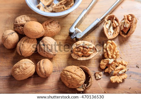 Walnuts and a nutcracker on a table