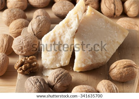 walnuts and cheese on a white background are a great food