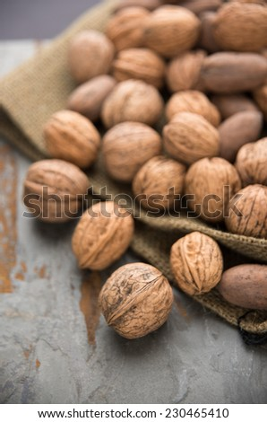 Walnuts and Pecans in Wooden Bowl on Concrete Counter