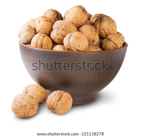 Walnuts In A Clay Bowl Isolated On White Background - stock photo
