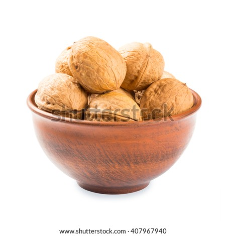 Walnuts in a clay bowl - isolated on white background - stock photo