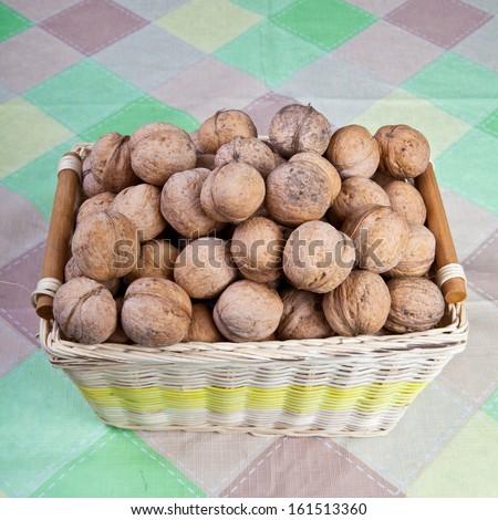 walnuts in a wicker basket - stock photo
