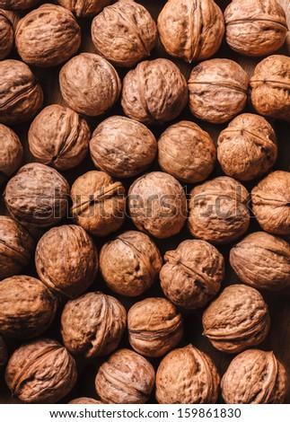 Walnuts In Shells Dark Background - stock photo