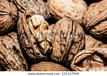 Walnuts in shells, one upon the other ( HDR image ) - stock photo