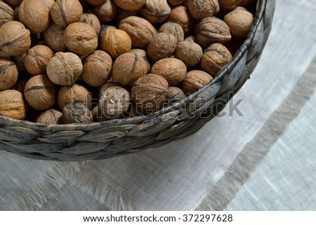 walnuts in wicker basket - stock photo