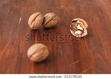 walnuts on a brown wooden table