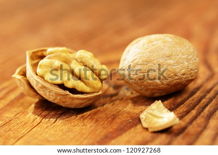Walnuts on a old wooden table, selective focus - stock photo