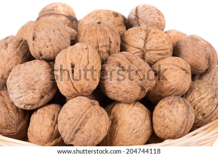 walnuts on basket. Isolated on a white background.