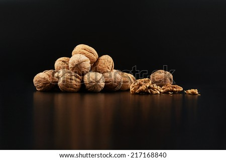 Walnuts on black background - stock photo